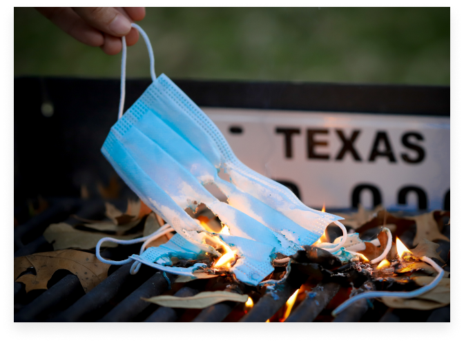 burning mask in front of texas license plate