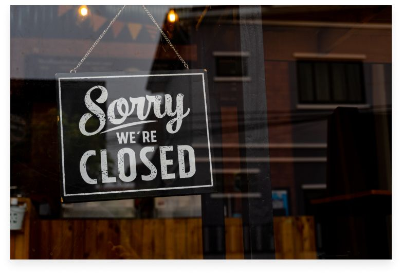 """""""Sorry we're closed"""" sign in venue window"""