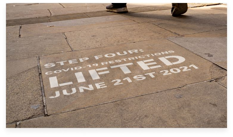 step 4 COVID-19 restrictions lived june 21st 2021 painted on sidewalk in the uk