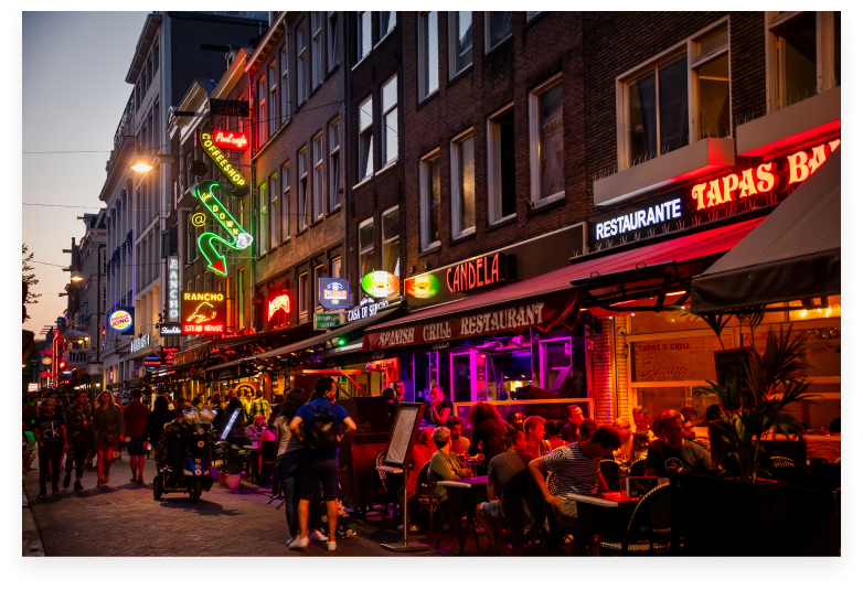 Crowded street in Amsterdam at night